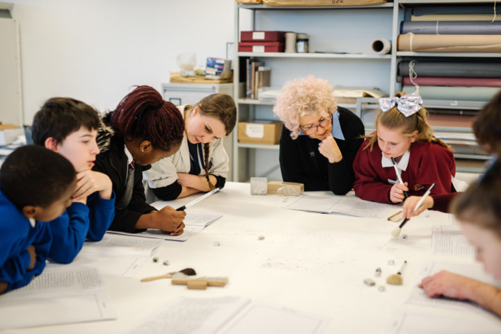 Conservators at Liverpool Record Office teach children about preserving historic artefacts