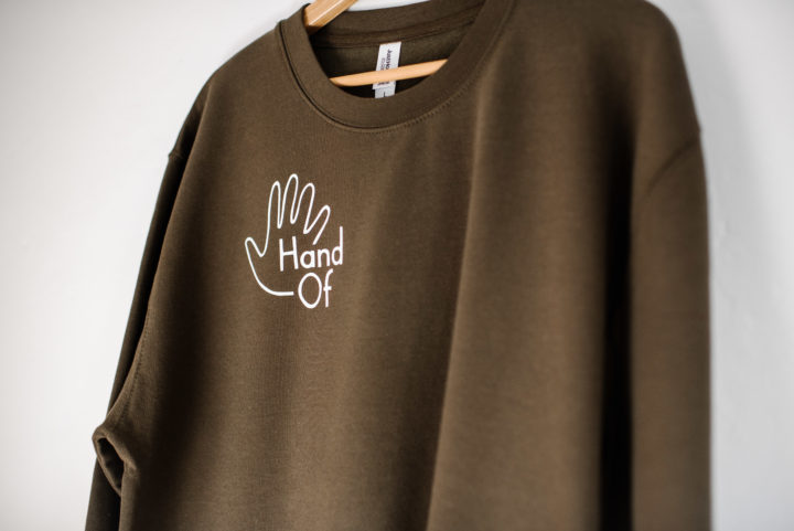 Hand Of jumper in olive green (upper front)