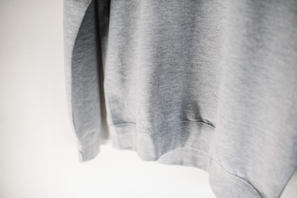 Hand Of logo jumper in grey (front bottom detail)