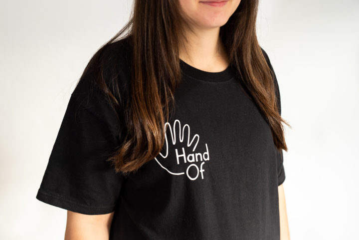 Hand Of short sleeve t-shirt (front detail), modelled by Meghan Lilleyman
