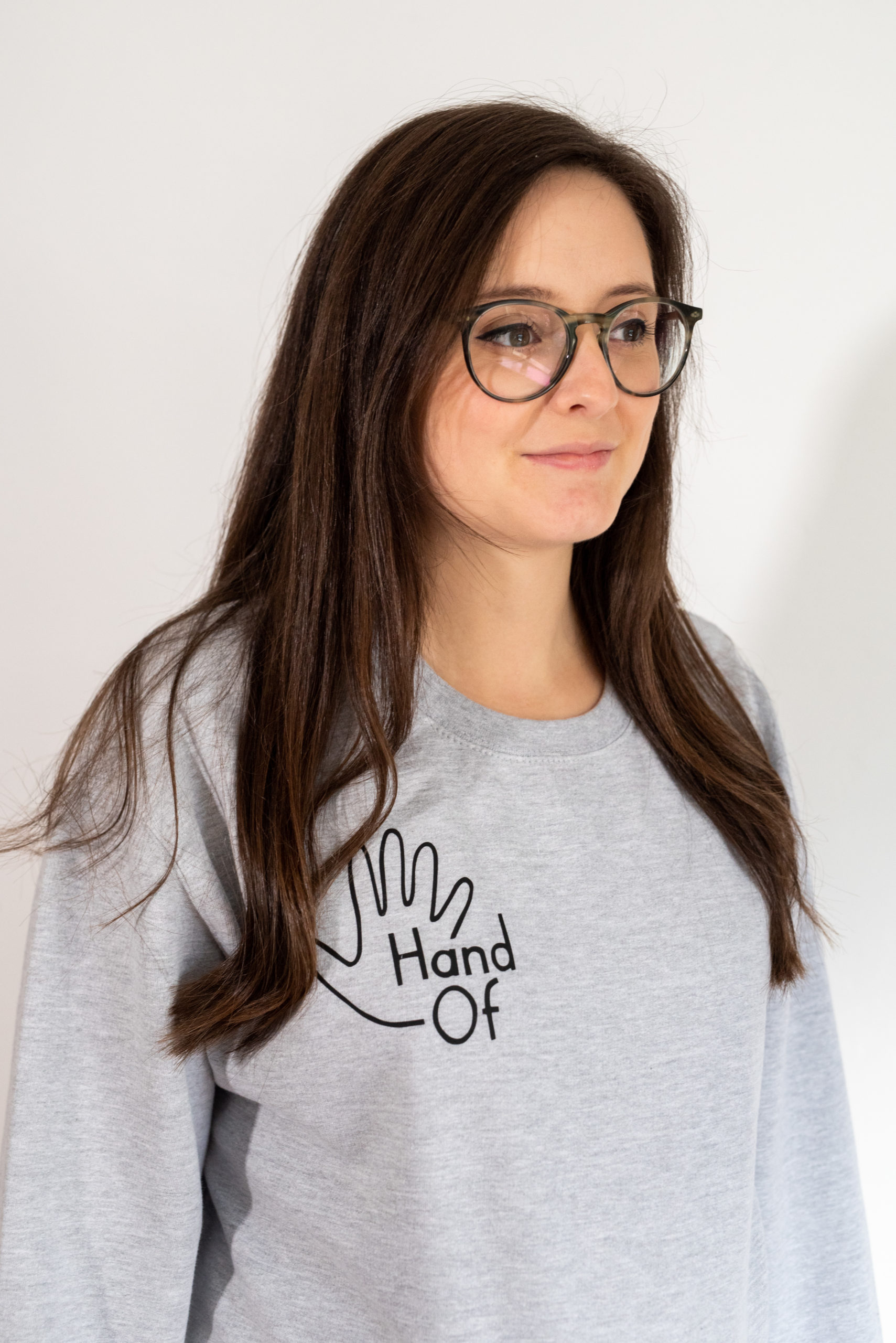 Hand Of jumper in grey, modelled by Meghan Lilleyman.