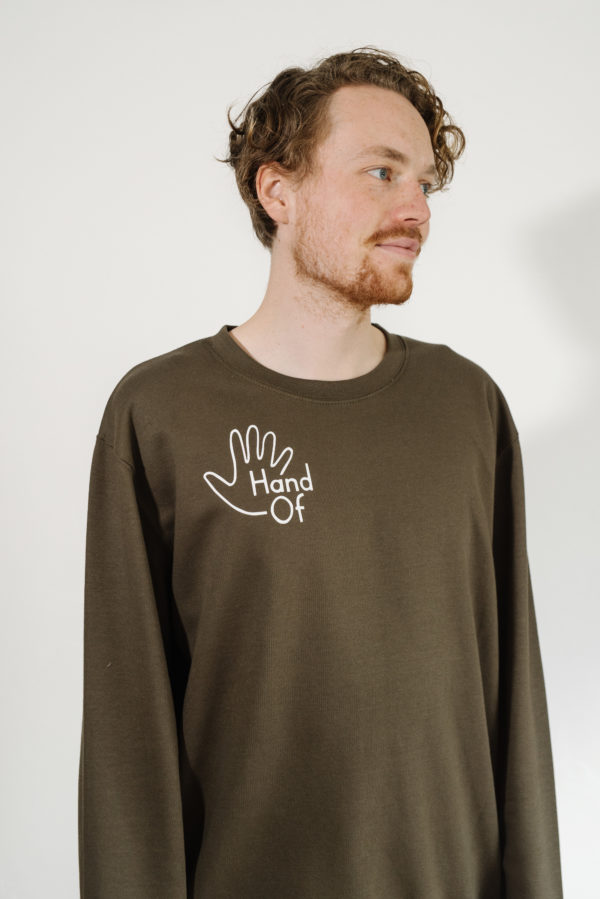 Hand Of logo jumper in olive green, modelled by Scott Hukins